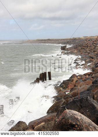 Crashing Fierce Waves Against Black Rocks At Coast