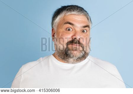Handsome Caucasian Plus Size Male Model Isolated On Blue Studio Background. Concept Of Inclusion, Hu