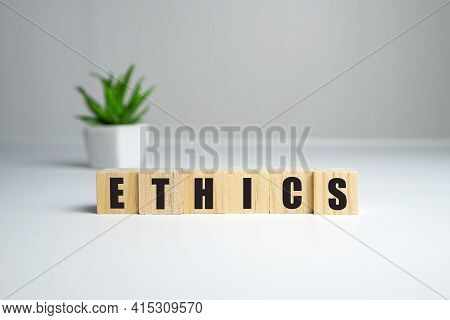 Wooden Blocks With The Word Ethic. Defending, Systematizing And Recommending Concepts Of Right And W