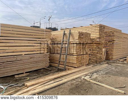 Wooden Boards, Lumber, Industrial Wood, Timber. Pine Wood Timber Stack Of Natural Rough Wooden Board
