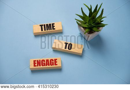 Time To Engage Text On Cubes On Blue Background