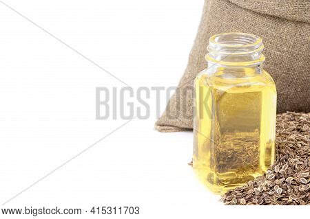 Dill Essential Oil. Glass Bottle Of Dill Oil.dill In A Sack Of Isolated On A White Background. Fenne