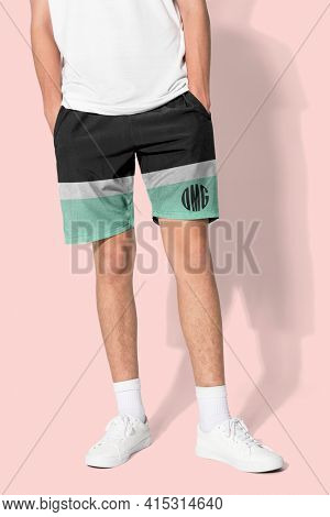 Man in black and green shorts with OMG graphics for summer apparel shoot