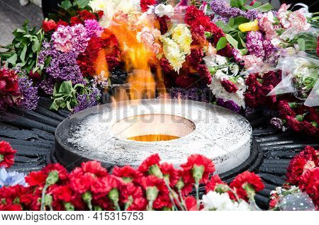 Eternal Flame. At The Monument To Fallen Soldiers. Flowers By The Fire.