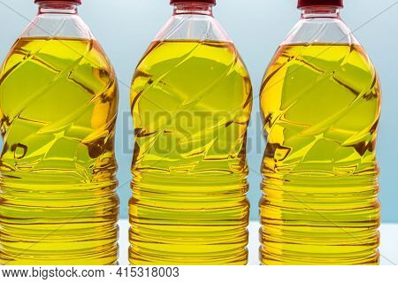 Plastic Bottles With Edible Soy Oil On Blue Background