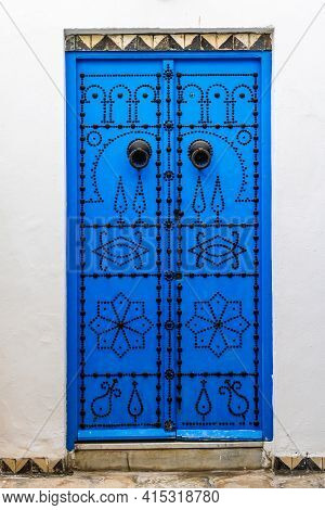 Decorative Blue Door. Typical Blue Studded Wood Or Iron Door In Sidi Bou Said, Tunisia, North Africa