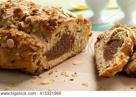 Traditional Dutch homemade easter bread and slices stuffed with almond paste,cinnamon and almonds close up
