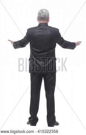 Man standing giving his back to the camera isolated over a white backgroud