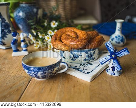 Delfts Blue Decorative Crockery On The Table With Traditional Dutch Zeeuwse Bolussen Pastry.