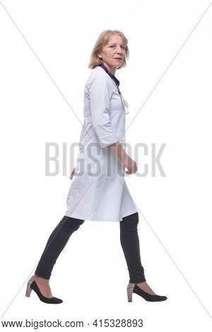 Full length portrait of medical doctor woman going sideways