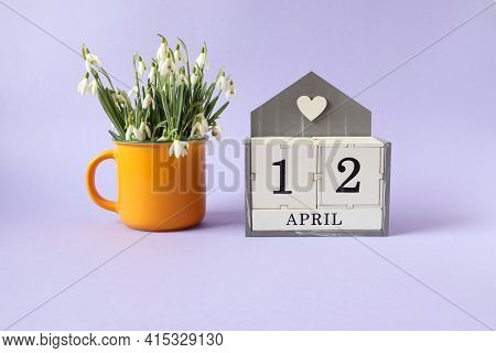 Calendar For April 12: Cubes With The Number 12, The Name Of The Month Of April In English, A Bouque