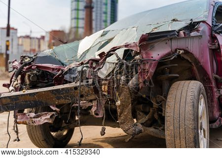 Close Up Of Broken And Abandoned Car. Smashed Car To Pieces After Accident On Street. Concept Of Car