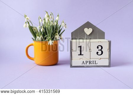 Calendar For April 13: Cubes With The Number 13, The Name Of The Month Of April In English, A Bouque
