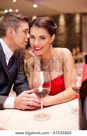 couple flirting in restaurant, passion love