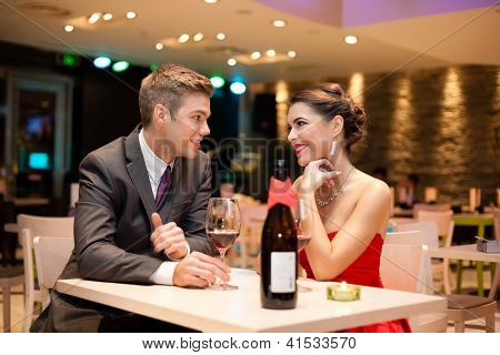Young couple on first date in romantic restaurant