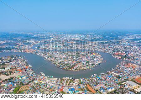 Aerial View Of Buildings With Curve Of Chao Phraya River. Samut Sakhon Skyline Near Bangkok, Urban C
