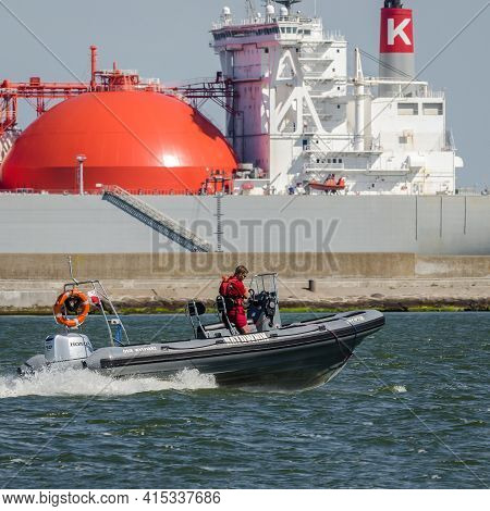 Swinoujscie, West Pomeranian / Poland - 2020: Lifeguard On A Fast Boat And Lng Tanker In The Backgro