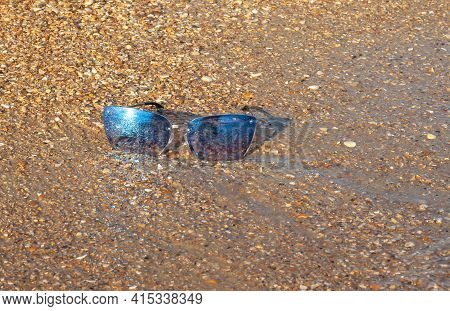 Forgotten Lost Sunglasses Lie On The Beach, As A Symbol Of The End Of Vacation And Travel. Empty, Ab