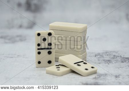 Details Of Board Game Dominoes On Abstract Gray Background. Game In Which You Try To Match Spots Of