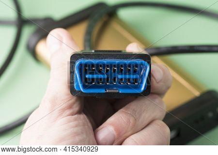 Electrician Holds In Hands Computer Car Diagnostic Error Scanner Obd2 Plug. Equipment, Diagnostic In