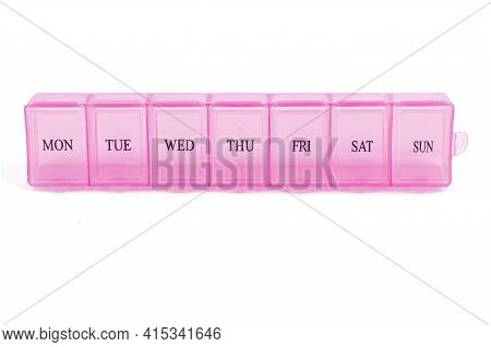 Pink Plastic Organizer, For Pills Isolated On White Background. Close-up On Compartments Pill Case W
