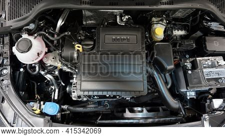 Modern Engine. Top View. On The Intake Manifold There Is The Mpi Lettering. Selected Focus.