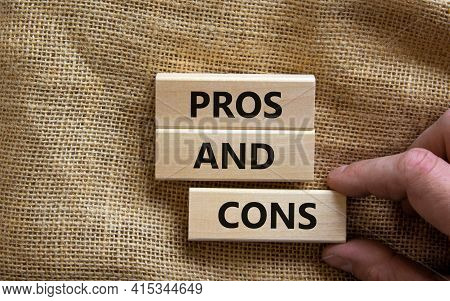 Pros And Cons Symbol. Wooden Blocks With Words 'pros And Cons'. Beautiful Canvas Background, Busines
