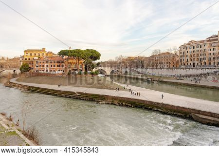 Rome. Italy. Spring 2020. Tiberina Island. Spring Roman Embankments. People Walk Along The Embankmen