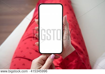 Female Hands In Red Suit Hold Golden Phone With Isolated Screen