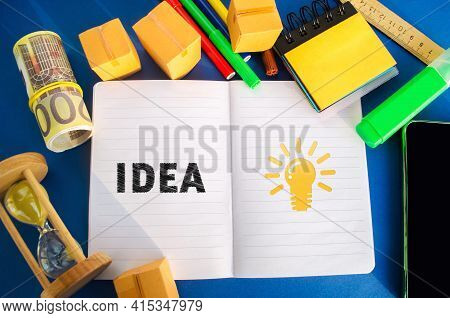 Notebook With Word Idea And Light Bulb Idea Icon. Concept Of New Innovation Ideas And Discoveries. V