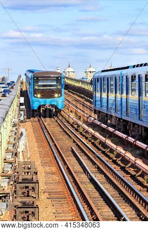 Metro Bridge In Kyiv, Along Which Two Metro Trains Rush Towards Each Other, Each On Its Own Side Aga