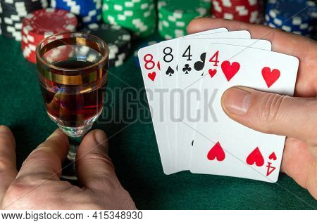 Poker Cards With Two Pairs Combination. Close Up Of A Gambler Hand Is Holding Playing Cards In Poker