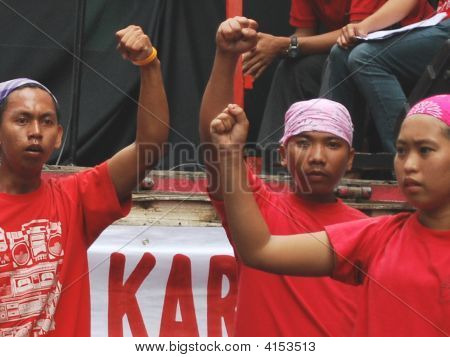 Clenched Fist Of Three Youth Red Artist