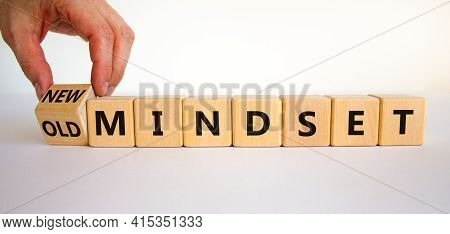 New Vs Old Mindset Symbol. Businessman Turns The Wooden Cube And Changes Words 'old Mindset' To 'new