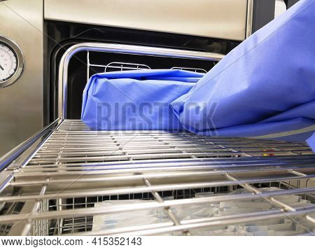 Packed Surgical Instrument Set Arranged In Sterilizer Trolley For Autoclave