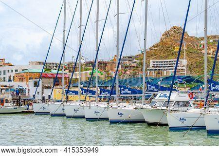 Cabo San Lucas, Mexico - October 13 2019: Empty Cabo Adventures Sailboats Docked On Ocean Coast Of M