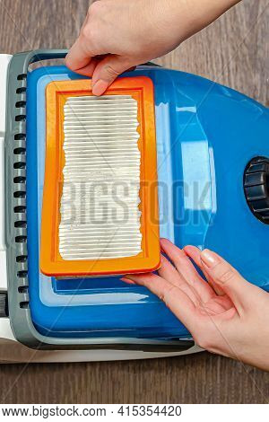 Manual Replacement Of The Air Filter In A Modern Washing Vacuum Cleaner. Removes The Filter Of The V