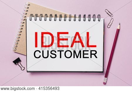 Text Ideal Customer On A White Sticker With Office Stationery Background. Flat Lay On Business, Fina