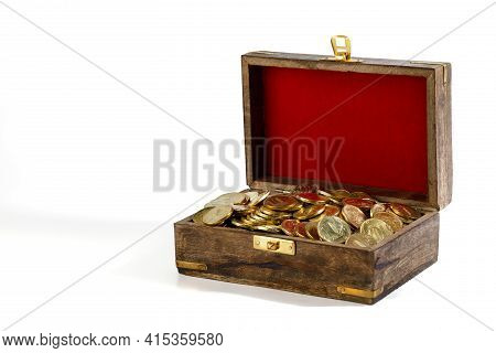 The Coins Are Gilded In A Wooden Old Chest With Red Velvet On The Lid, Isolated On A White Backgroun