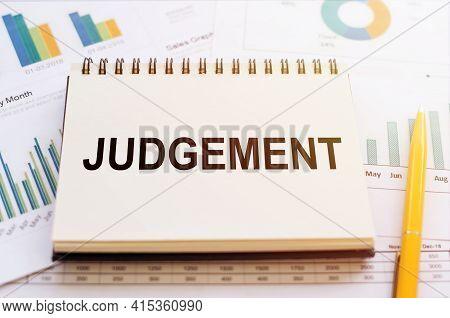Word Judgement Written On Calculator On Office Table.