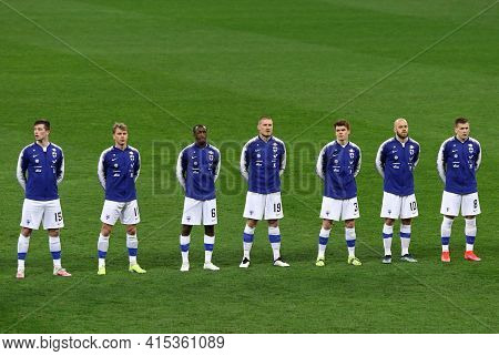 Kyiv, Ukraine - March 28, 2021: Finnish Players Listen To The National Anthem Before The Fifa World