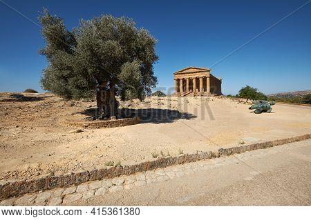 Temple Of Concordia, Or Tempio Della Concordia In Italian. Temple Building With Olive Tree. Valley O
