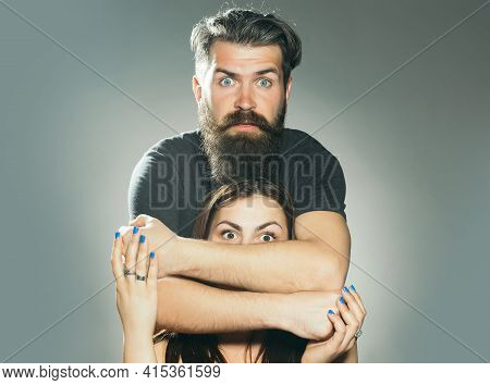 Surprised Man Embracing Woman. Handsome Bearded Man With Surprised Face Embracing Young Woman Toples