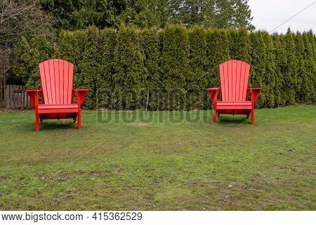 April 2,2021 Vancouver British Columbia Canada Two giant adirondack chairs at Vandusen Botanical Garden