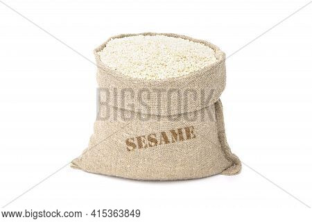 Seeds Of Sesame In A Sack Of Isolated On A White Background. Til In A Burlap Sack. Healthy Food. Ben
