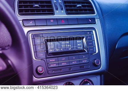 Novosibirsk, Russia - April 01 2021: Volkswagen Polo, Audio Stereo System, Control Panel  Under Pink