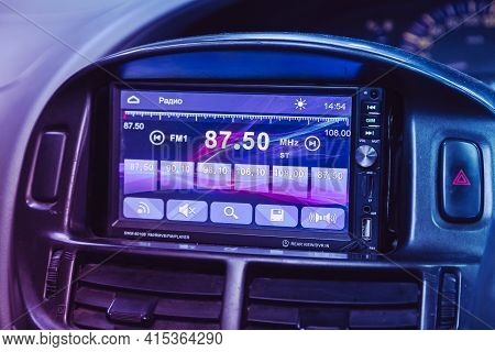 Novosibirsk, Russia - April 01 2021: Toyota Estima, Audio Stereo System, Control Panel  Under Pink N