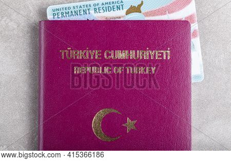 A Us Permanent Resident Card A.k.a Green Card Inside A Turkish Passport. Concept Image For Green Car
