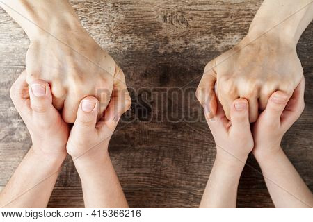 Abstract Concept Image Showing Two Kids Tightly Holding Hands Of A Woman. Single Mom With Two Kids,