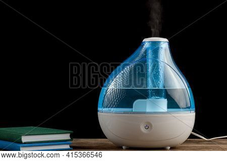 Winter Night, Cold, Flu Concepts With An Ultrasonic Air Humidifier Creating Cool Mist Water Vapor. S
